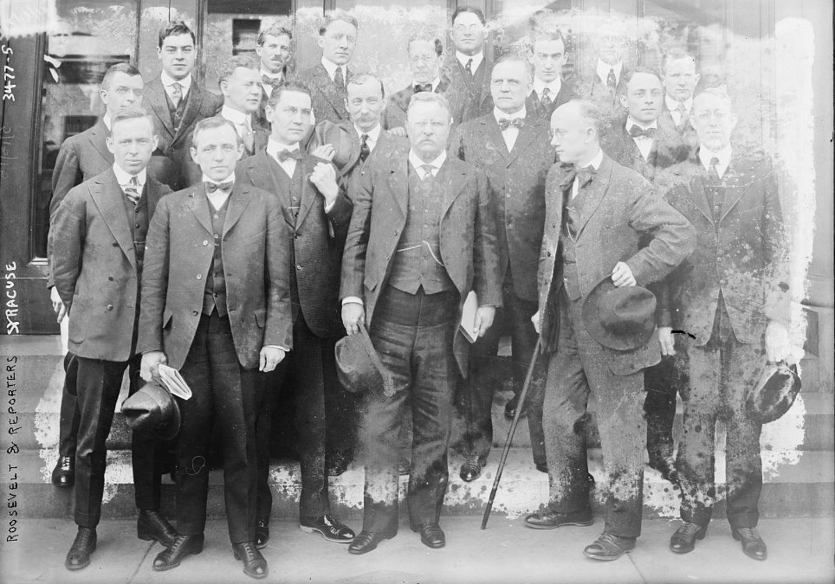 Theodore Roosevelt with reporters during his trial for libel in Syracuse, New York.
