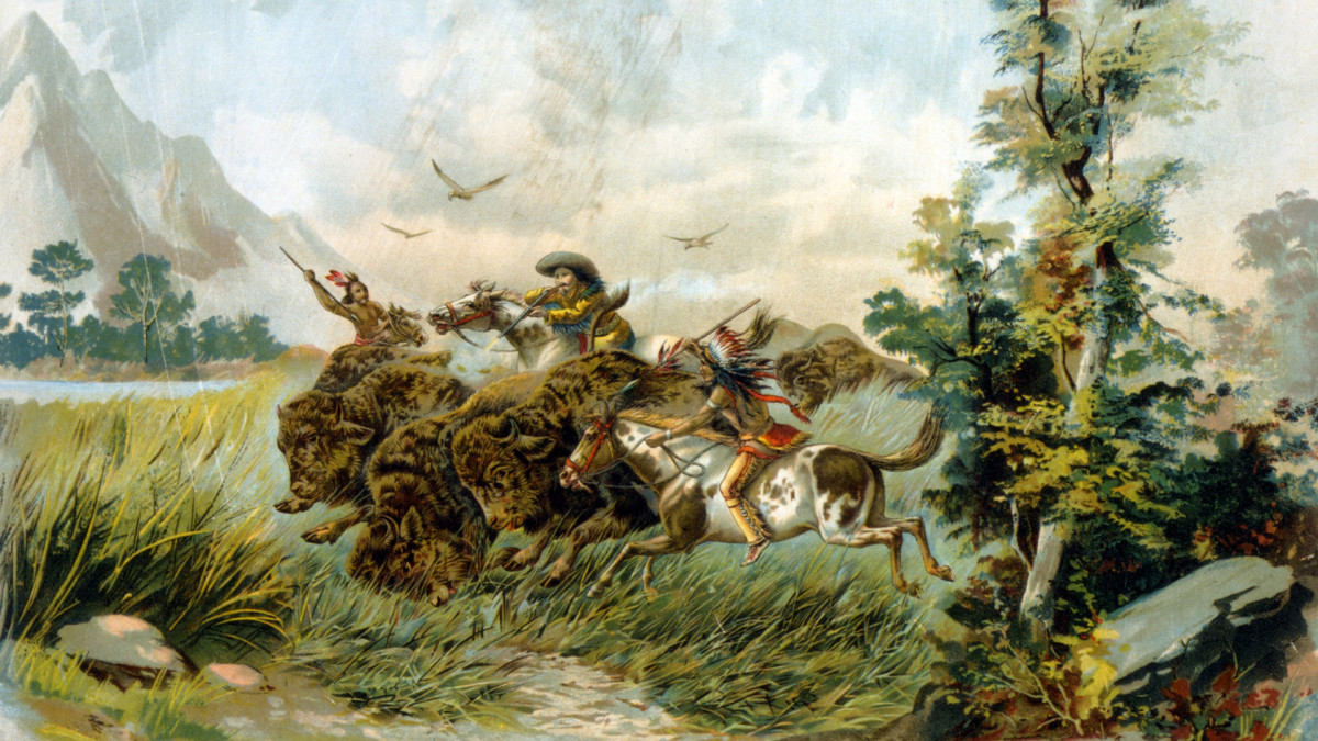 A buffalo hunter shooting a buffalo as two Native Americans ride alongside with spears.