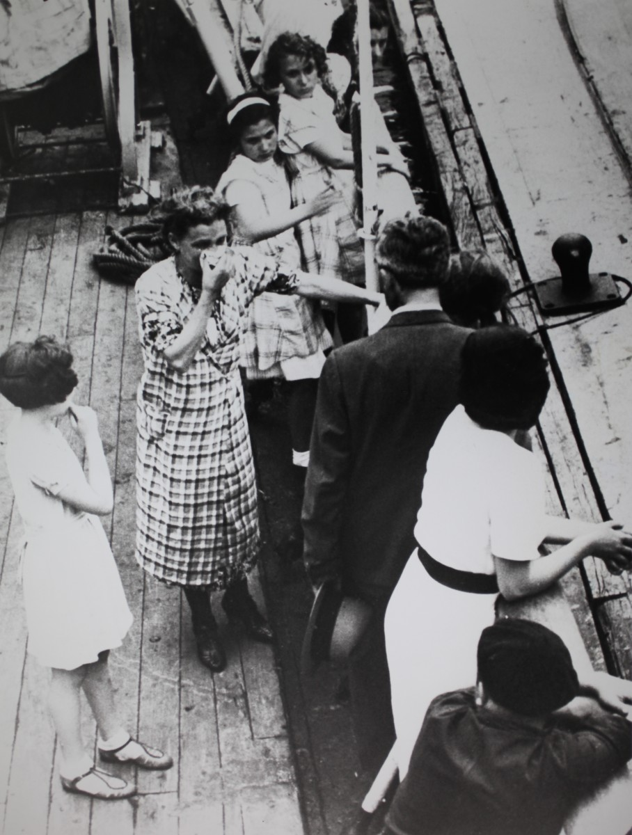 A woman who was denied entry in Havana is seen crying while surrounded by her children aboard the M.S. St Louis in June 1939.