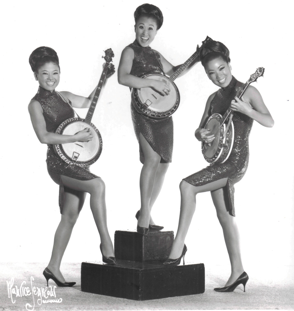 The Kim Sisters playing banjos in the 1960s. The Kim Sisters are considered to have laid roots as one of the first popular Korean crossover groups.