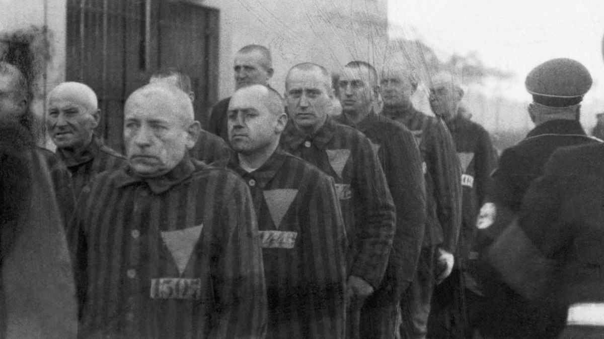 Homosexual prisoners at the concentration camp at Sachsenhausen, Germany, wearing pink triangles on their uniforms on December 19, 1938.