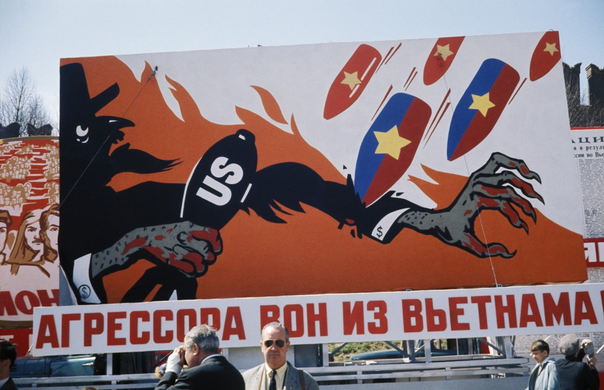 A Cold War-era billboard in Moscow showing bombs raining down on Uncle Sam reading, 'Aggressors out of Vietnam!' in 1968.
