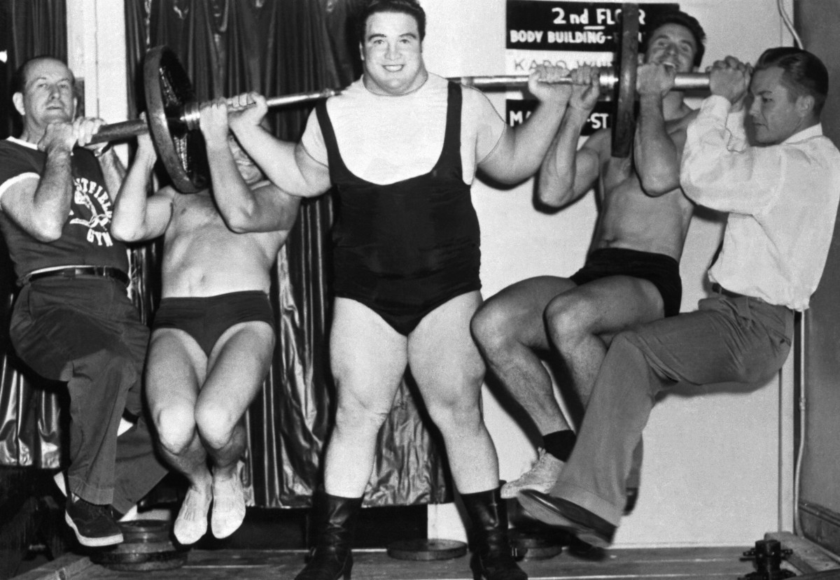Paul Anderson demonstrating his strength by lifting four husky associates in a contest in Atlanta, Georgia, 1954.