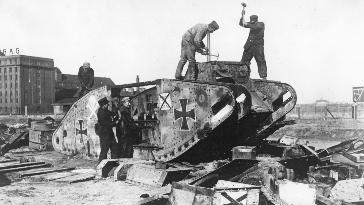 Germans take war machines apart outside Berlin under the terms of the Treaty of Versailles Germany. This tank is in fact a British tank, captured and put into service by the Germans during World War I.