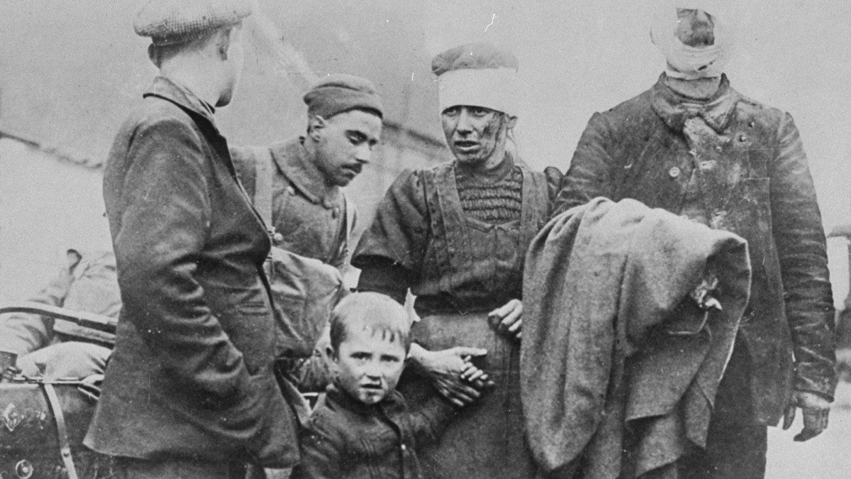 A bloodied Belgian family wounded by the Germans during World War I.