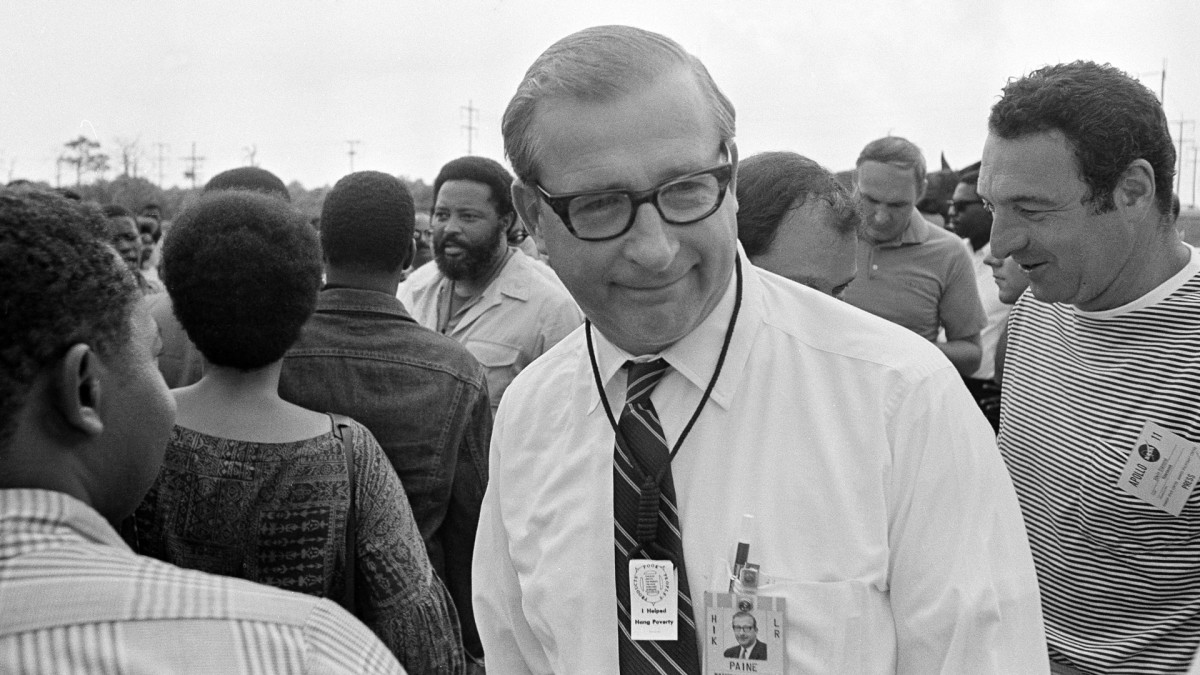 "NASA Administrator Thomas Paine wears a miniature ""hangman's noose"" around his neck with a note that reads ""I Helped Hang Poverty,""given to him by Reverend Ralph Abernathy on July 15, 1969."