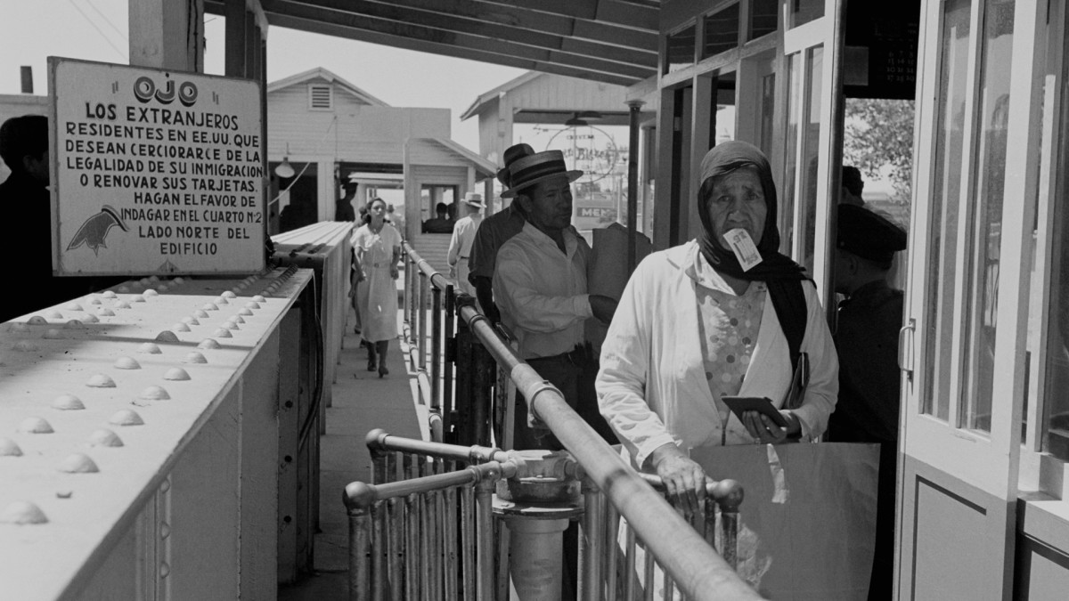 Mexican citizens entering the United States at an immigration station in El Paso, Texas, 1938.