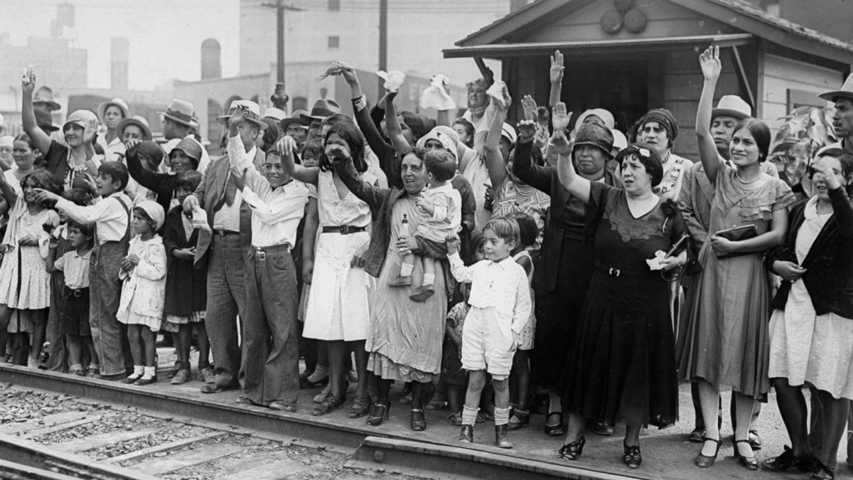 Relatives and friends wave goodbye to a train carrying 1,500 people being expelled from Los Angeles back to Mexico in 1931.