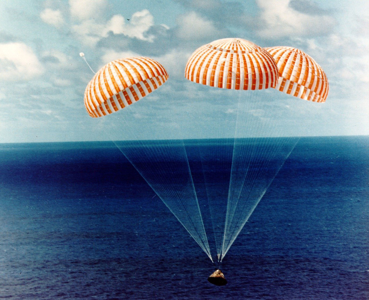 Parachutes assist the splashdown of the Apollo 14 Command Module.