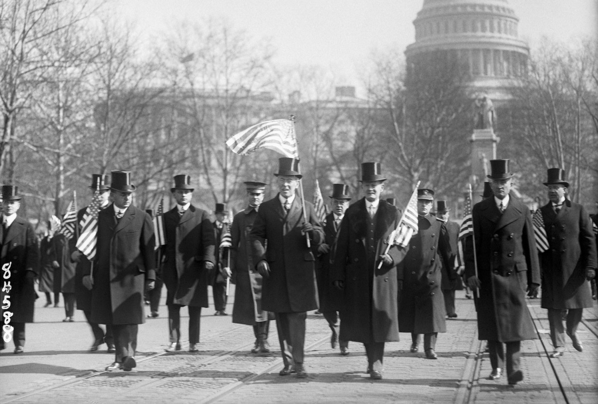 President Wilson leading the parade of the Capital's returning veterans in February 1919. He did not take any action once violence towards black veterans broke out later that year.