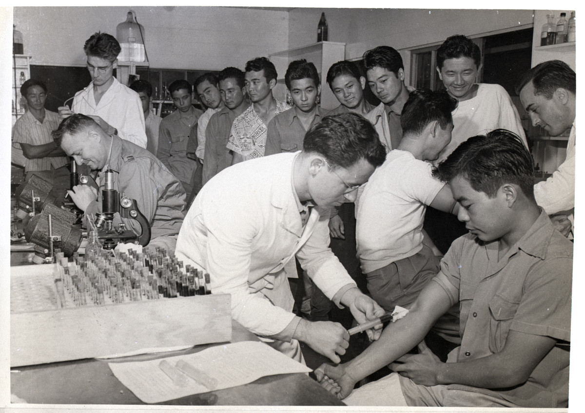Japanese-Americans army inductees in Hawaii getting blood drawn.