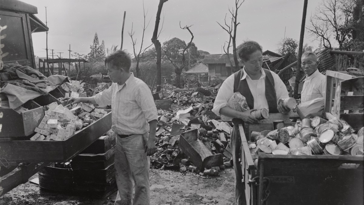Japanese-American merchants salvaging what goods were left in their stores, after the attacks on Pearl Harbor in Hawaii.
