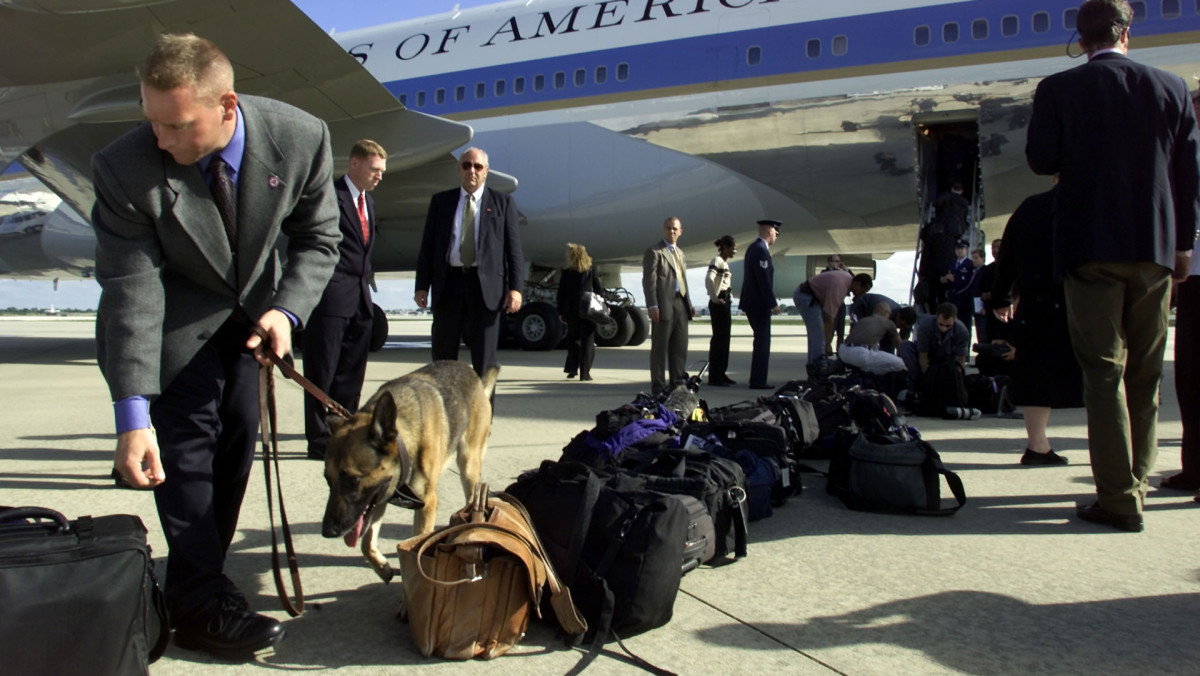 US Secret Service and Military police go on high alert and double up security checks for all passengers boarding Air Force One as President George W. Bush departs Sarasota, Floridas after learning about the attacks on September 11, 2001.
