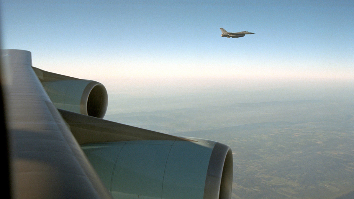 An F-16 escorts Air Force One from Offutt Air Force Base in Nebraska to Andrews Air Force Base on September 11, 2001.