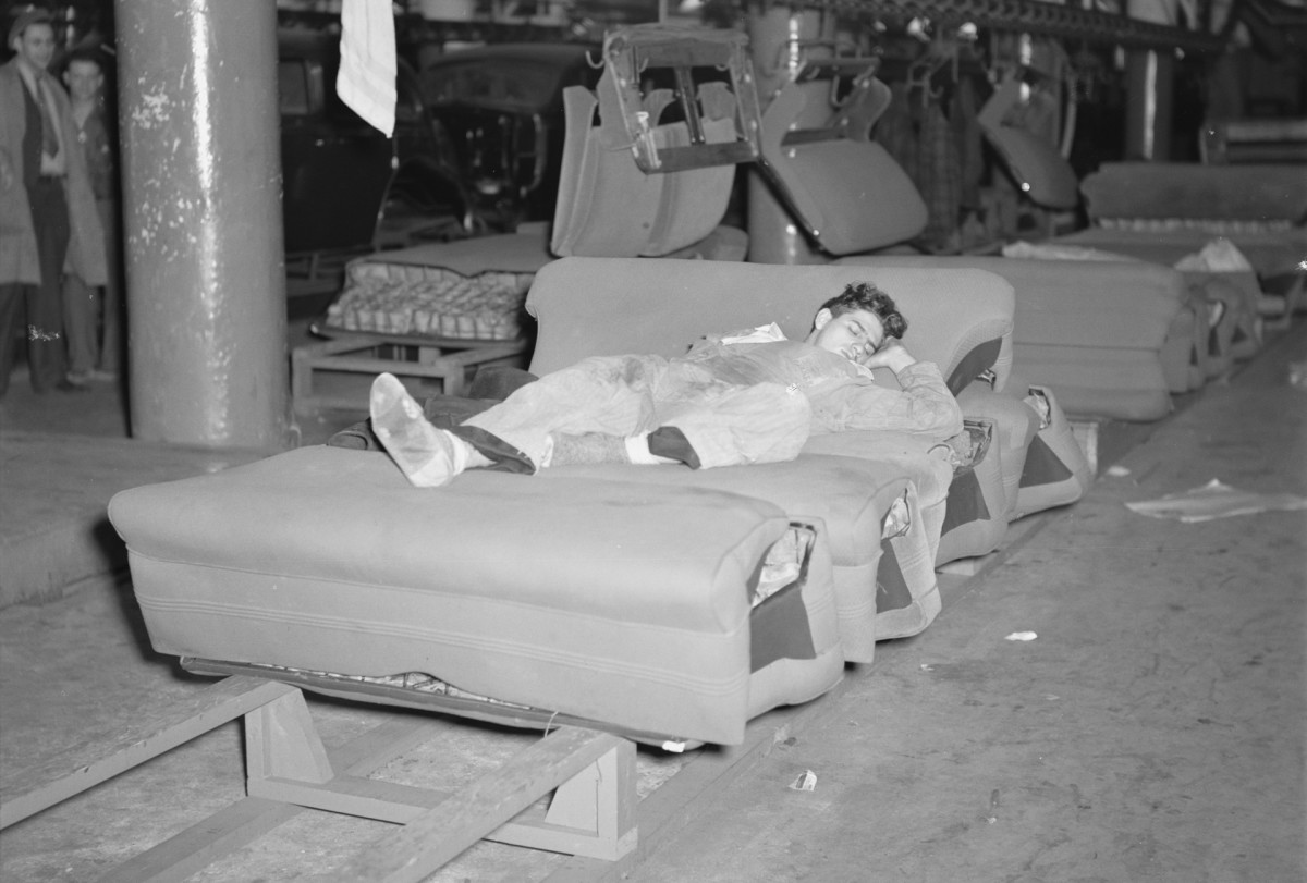 A young striker sleeping on an assembly line of auto seats in the body plant factory.