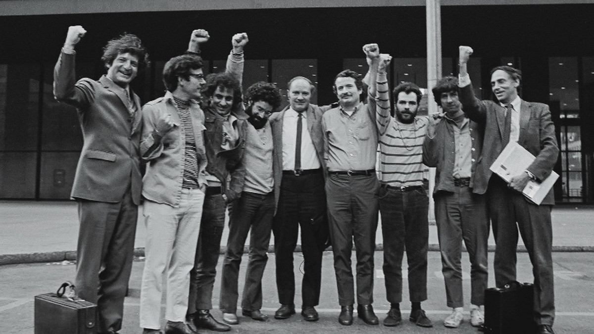 Portrait of the Chicago Seven and their lawyers as they raise their fists in unison outside the courthouse where they were on trial for conspiracy and inciting a riot during the 1968 Democratic National Convention in Chicago, Illinois, 1969. (L-R) Lawyer Leonard Weinglass, Rennie Davis, Abbie Hoffman, Lee Weiner, David Dellinger, John Froines, Jerry Rubin, Tom Hayden, and lawyer William Kunstler.