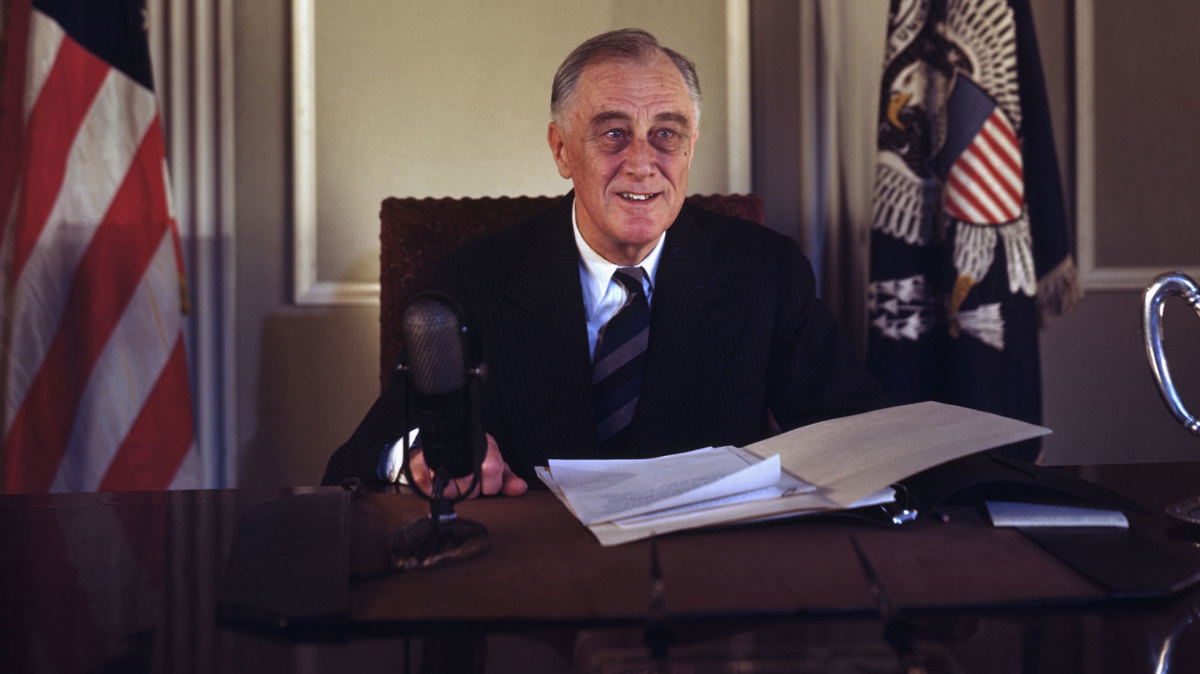 This photograph of Franklin D. Roosevelt seated at his desk was the last color image of him before the announcement of his death.