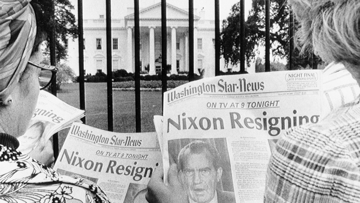 People read about President Nixon's resignation outside the gate of the White House in August, 1974.