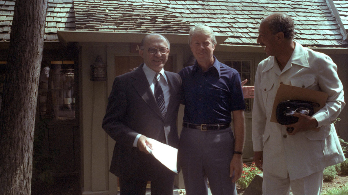 Israeli Prime Minister Menahem Begin with Egyptian President Anwar Sadat and President Jimmy Carter during their peace talks on September 6, 1978 at the presidential retreat of Camp David in Maryland.