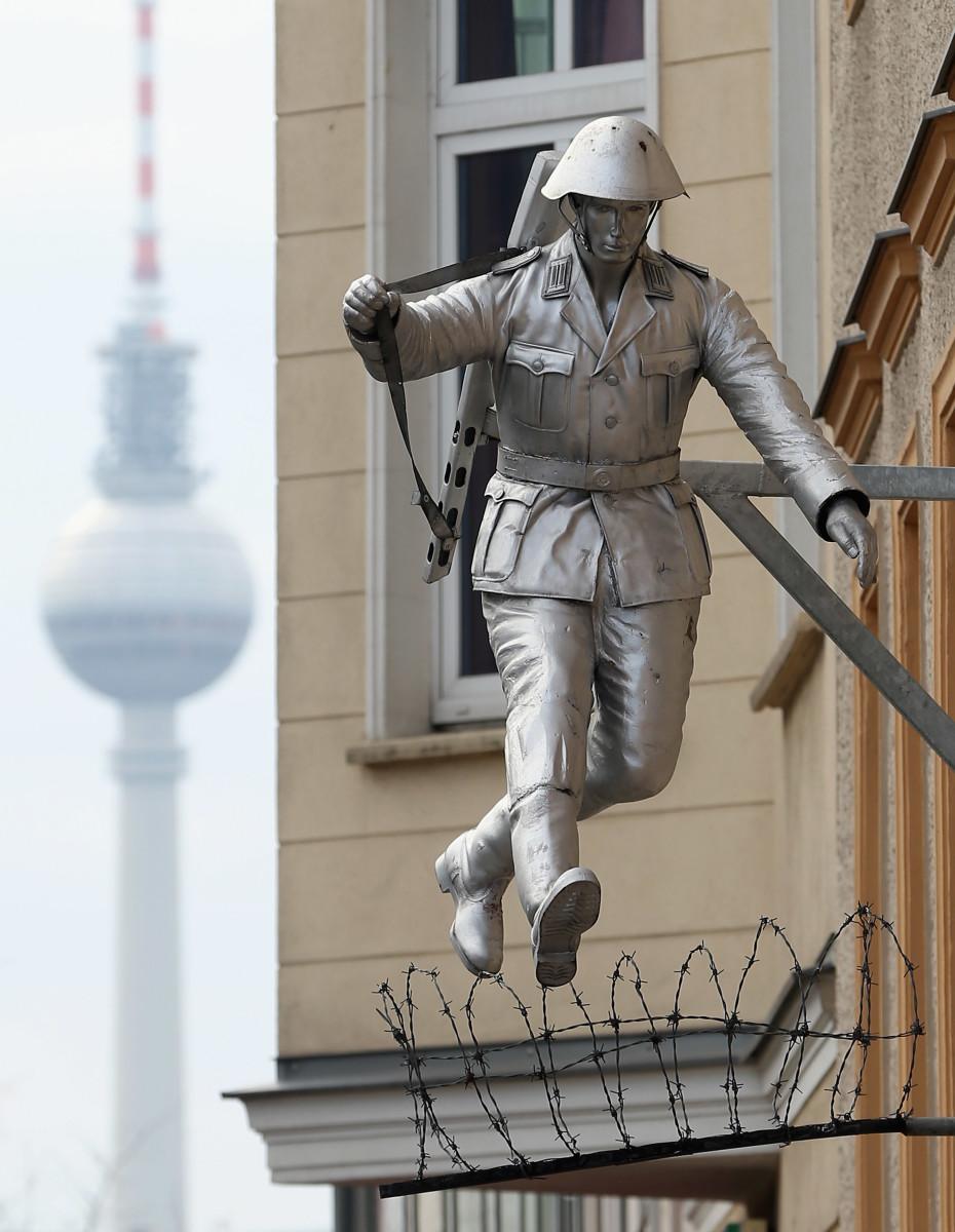 A statue of East German soldier Conrad Schumann, who famously jumped across barbed wire into West Berlin in 1961.