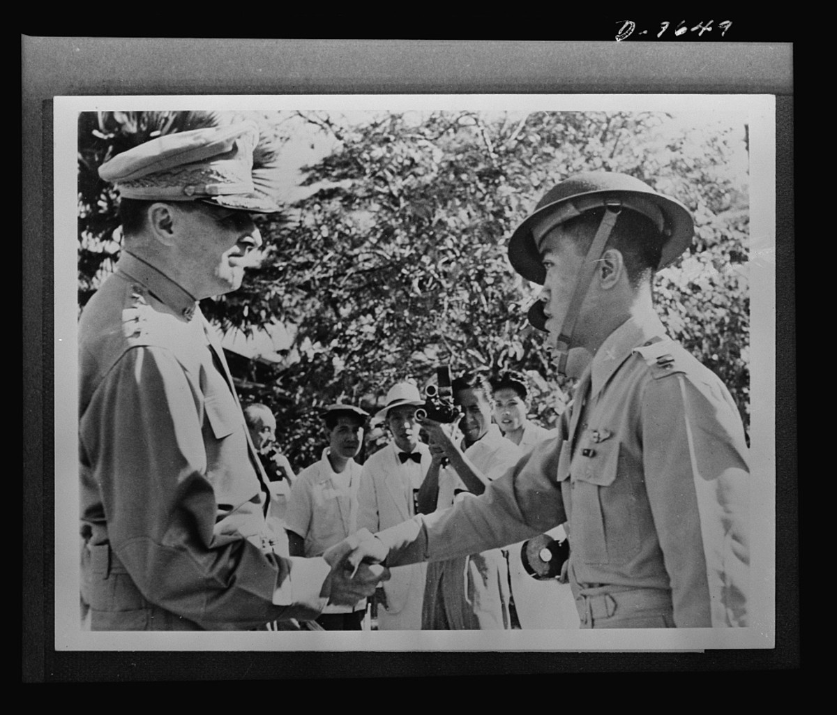 General Douglas MacArthur, left, congratulates Captain Villamor of the Philippine Air Force, after awarding him the Distinguished Service Cross, December 22, 1941.