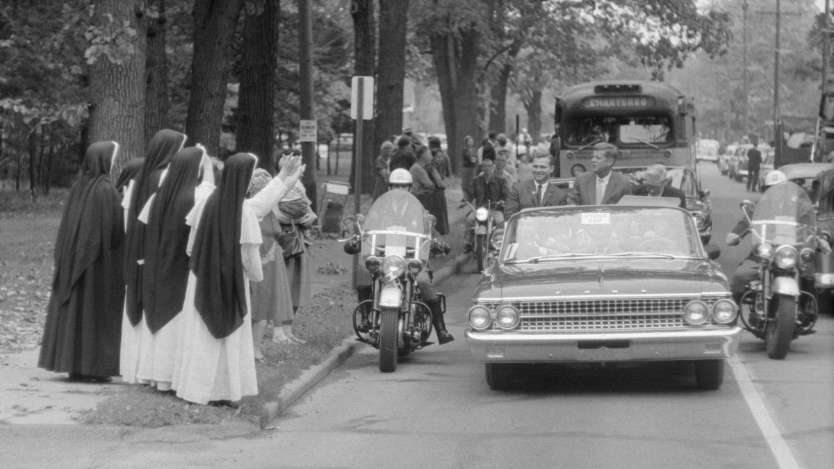 A group of Roman Catholic nuns were among spectators who lined the route taken by Democratic Presidential nominee John F. Kennedy in a campaign swing through Grand Rapids, Michigan on October 14, 1960.