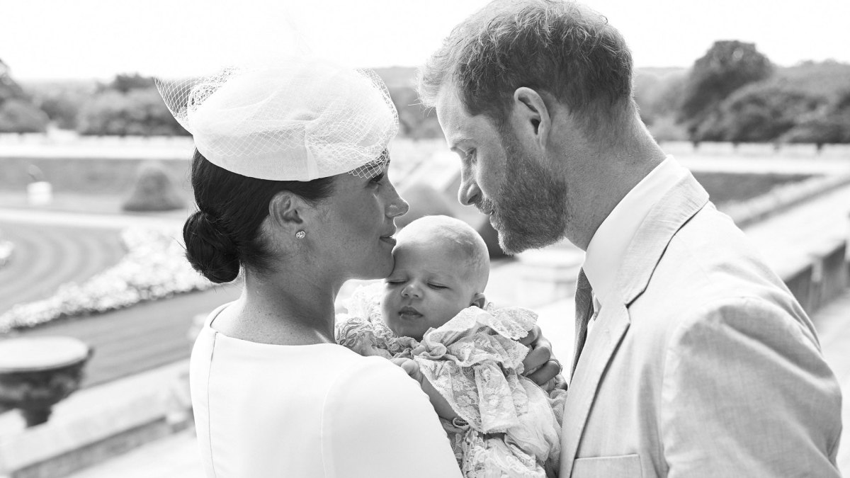 Prince Harry, Duke of Sussex, and his wife Meghan, Duchess of Sussex holding their baby son, Archie Harrison Mountbatten-Windsor at Windsor Castle on July 6, 2019.