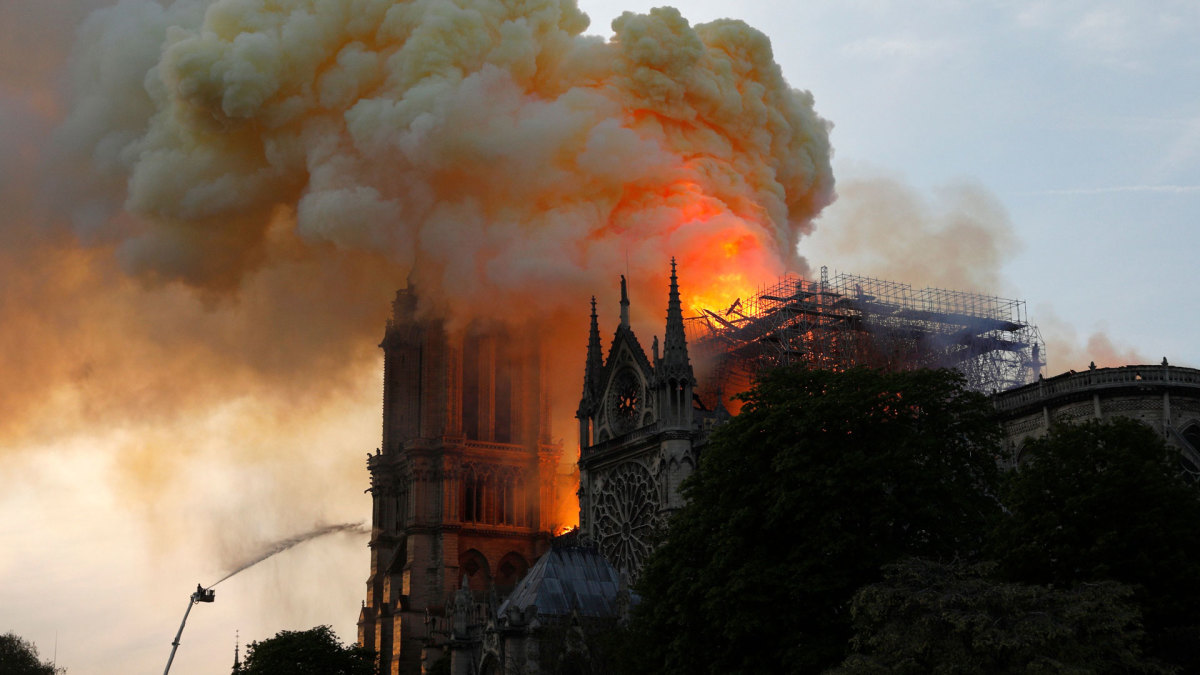 Flames and smoke billow from the roof at Notre-Dame Cathedral in Paris, the most visited historic monument in Europe, on April 15, 2019.