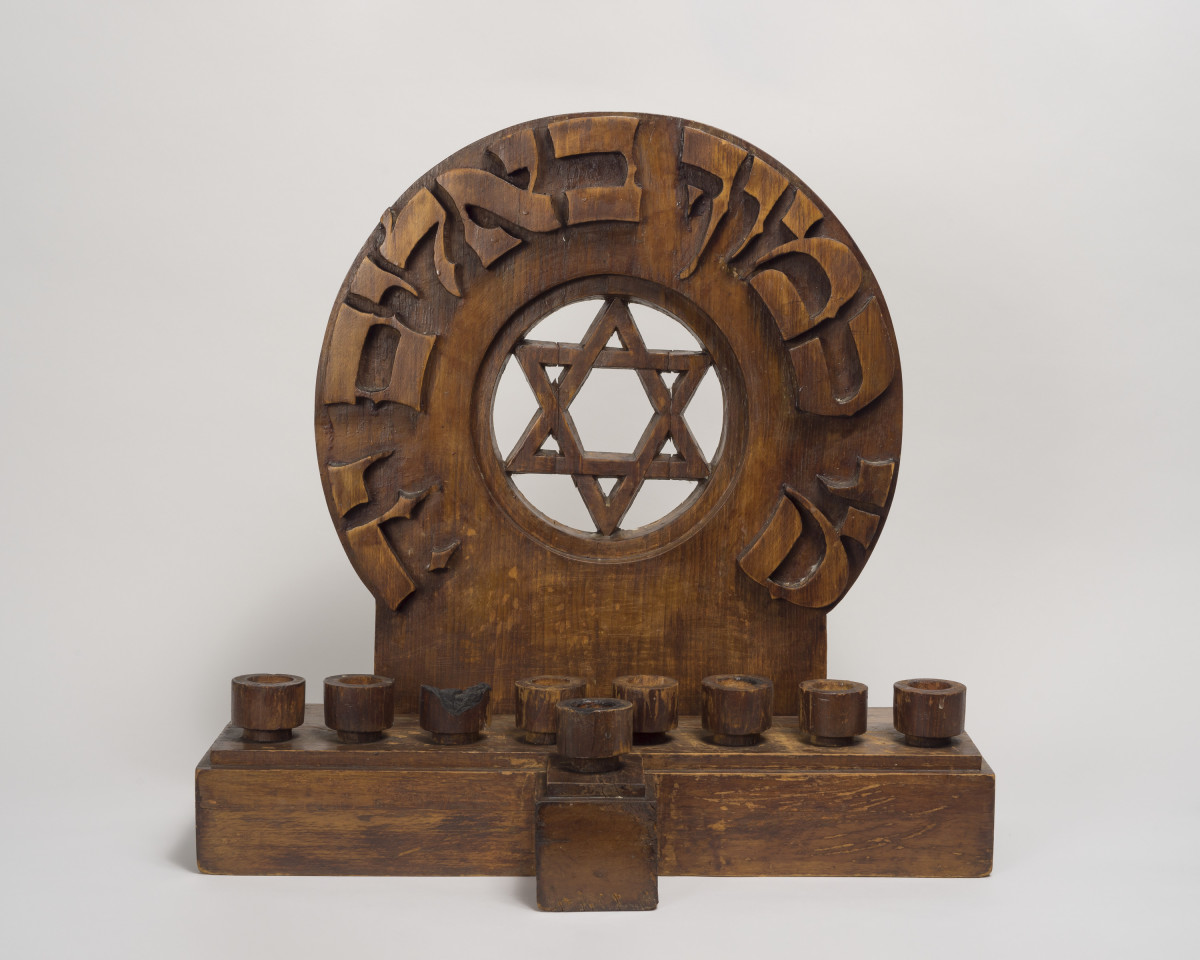 Hanukkah Lamp, made by Arnold Zadikow (German, 1884-1943) and Leopold Hecht (Czech, 1912-1994) in Theresienstadt, Czechoslovakia, 1942.