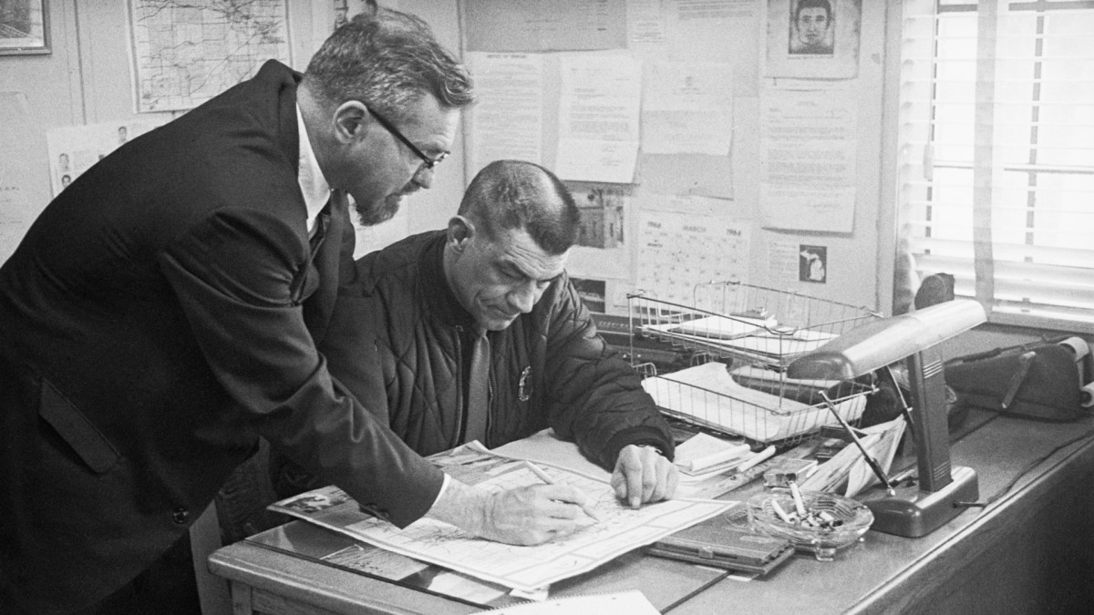 Dr. J. Allen Hynek with Police Chief Robert R. Taylor of Dexter, Michigan going over a county map spotting where the flying objects were seen, 1966.
