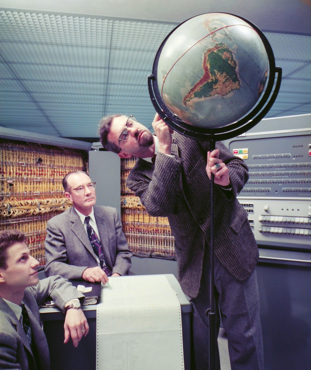 Dr. J. Allen Hynek (right) pointing out a spot on a globe to fellow scientists while discussing the path of Sputnik 1, the first artificial satellite launched into low Earth orbit by the Soviet Union, in Cambridge, Massachusetts, October 1957. (