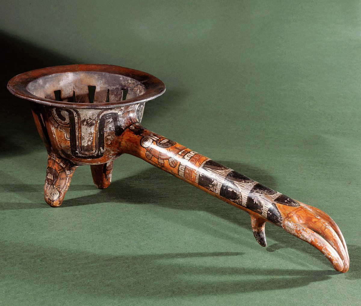 An Aztec incense burner, the handle in the form of Tezcatlipoca, the turkey claw.