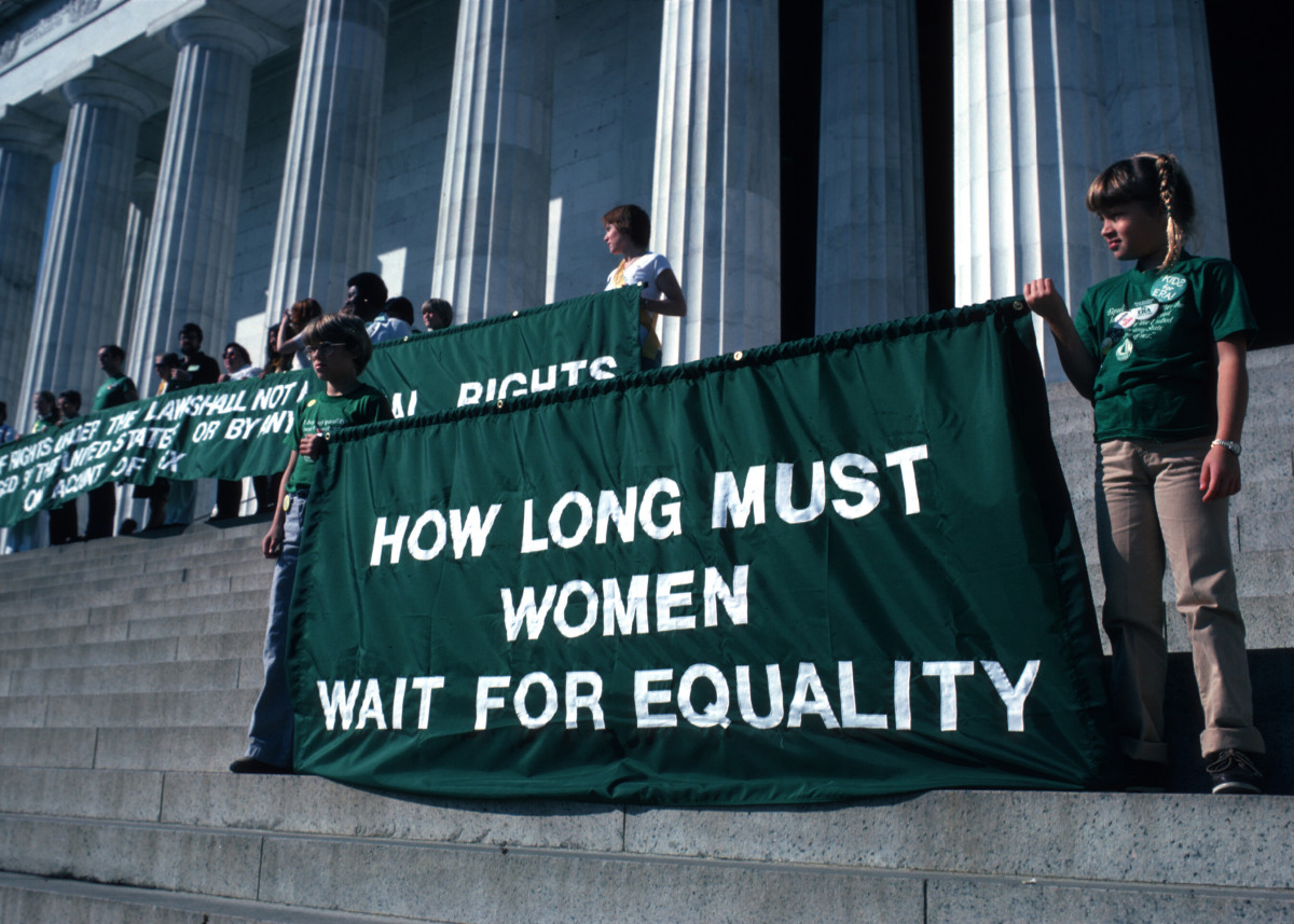 Young girls hold up banners at the 'Call to the Nation's Conscience' Equal Rights Amendment rally on the steps of the Lincoln Memorial in 1981.