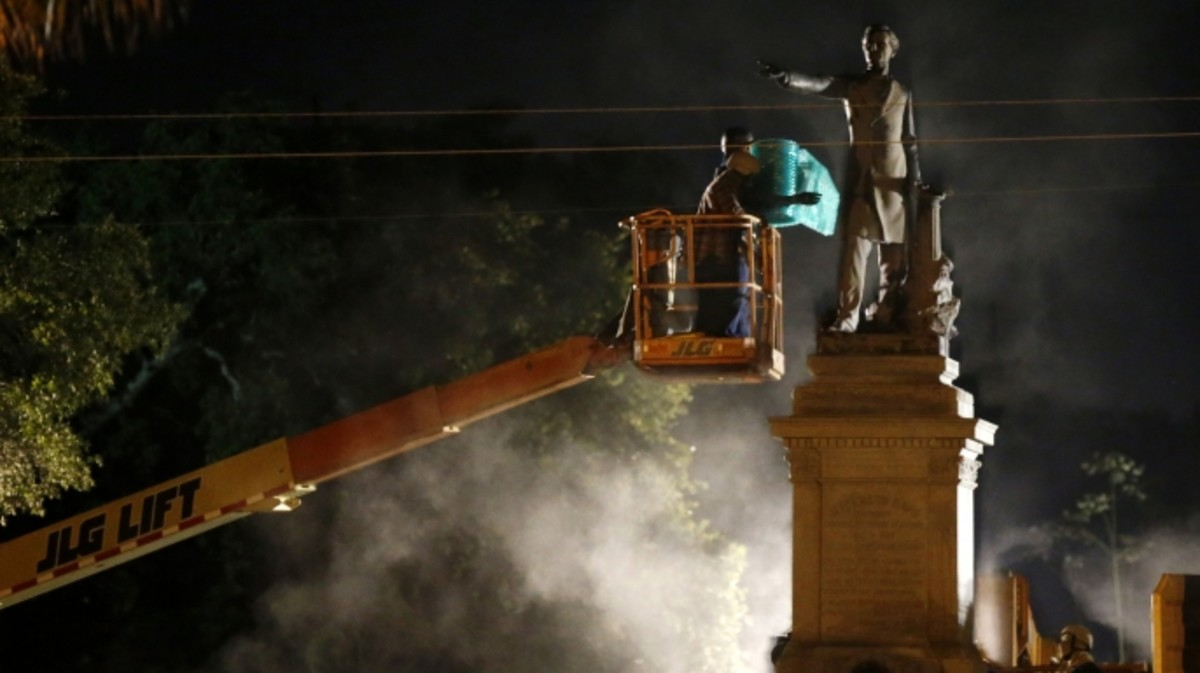 Workers prepare to take down the Jefferson Davis statue in New Orleans, Thursday, May 11, 2017. This was the second of four Confederate monuments slated for removal in a contentious process that has sparked protests on both sides.