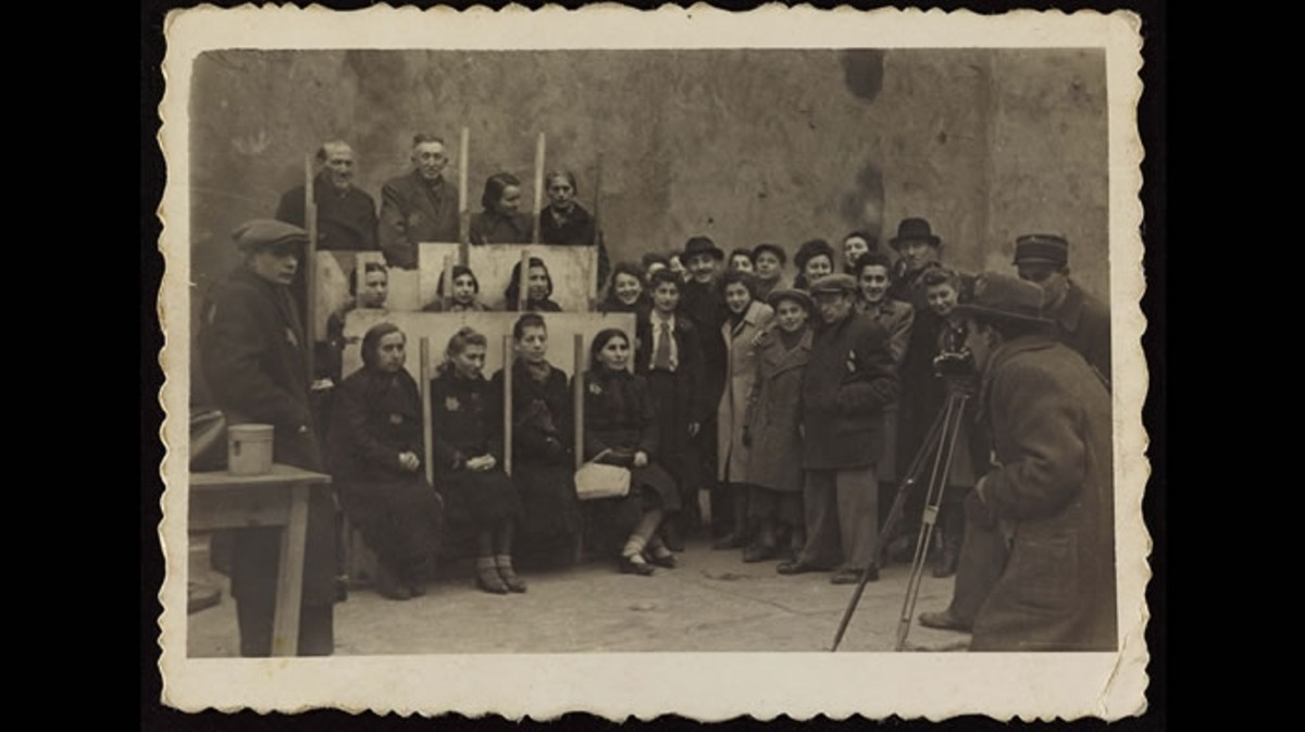 Henryk photographing for identification cards, Jewish Administration Statistics Department c. 1941.