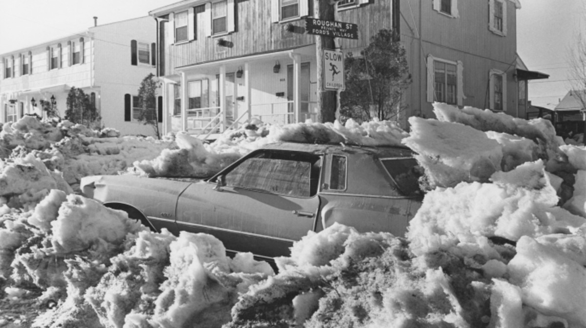 A car covered in snow on a street in Revere, Massachusetts, after a 27-inch snowfall during the Northeastern United States blizzard of 1978.