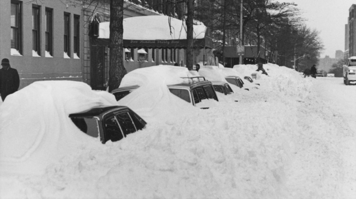 Snowdrifts covering parked cars on 110th Street after more than 20 inches of snow fell in two days in New York City in 1996.