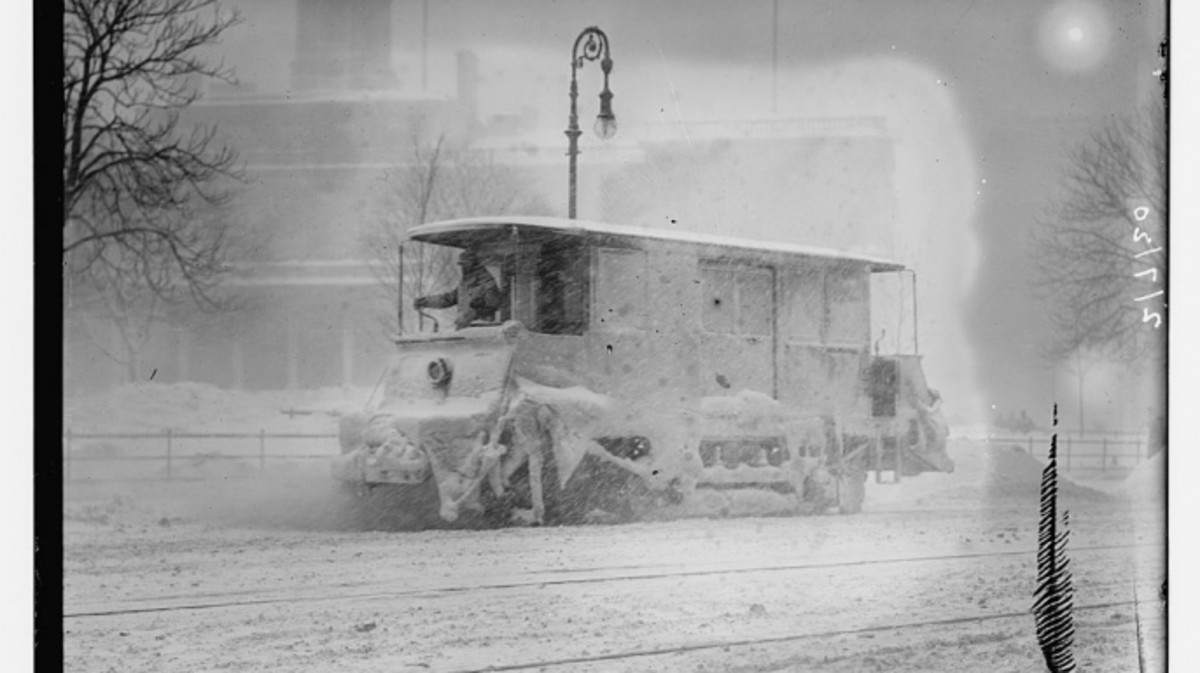 Snow plow during storm, New York.