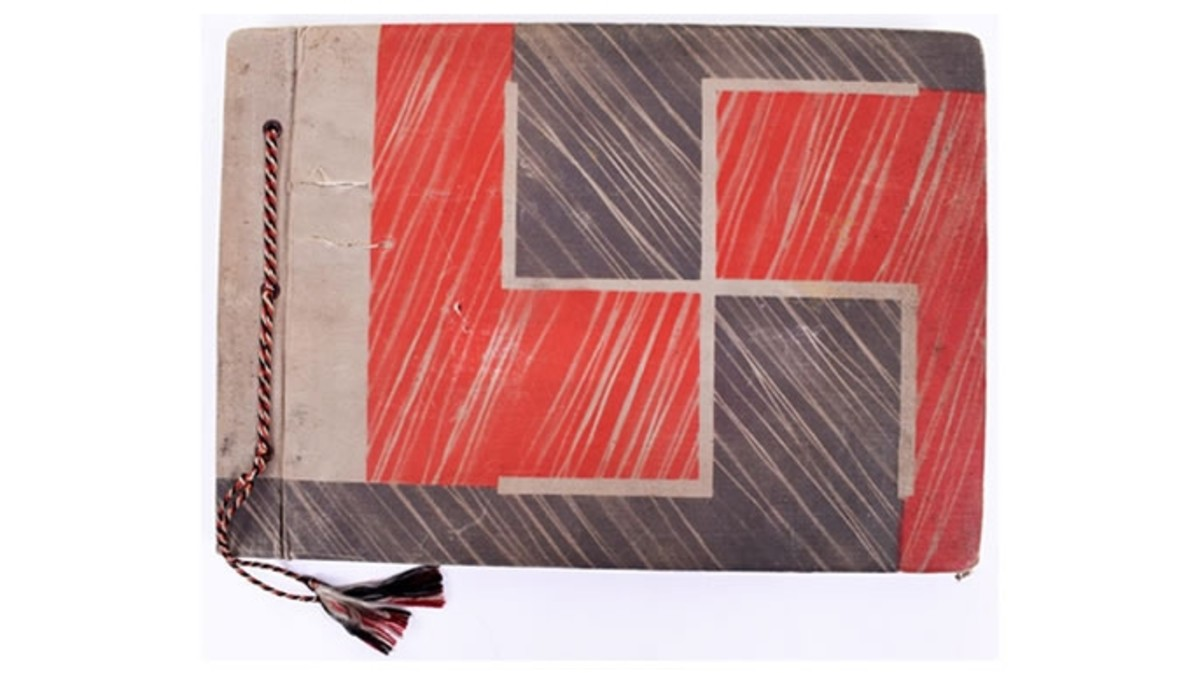 The photo album cover, with engraved swastika.