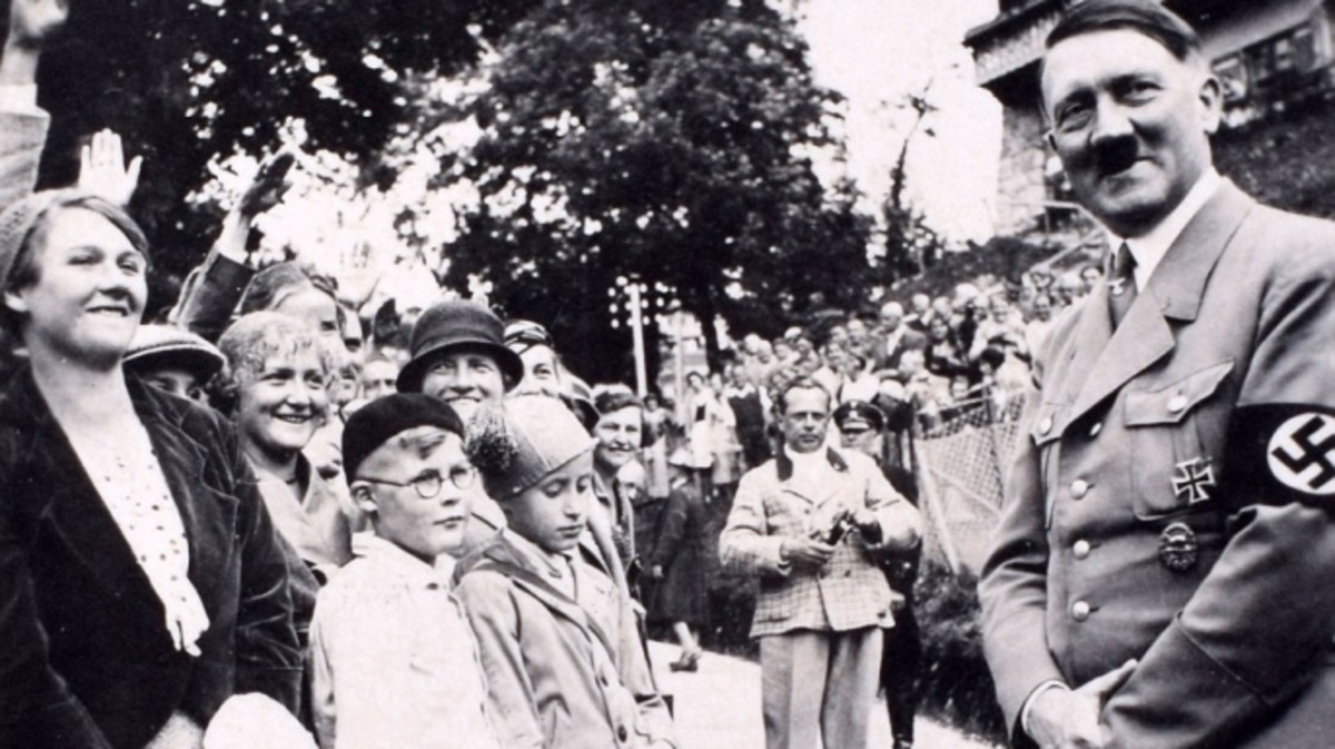 Hitler greeting crowds during a wartime rally.