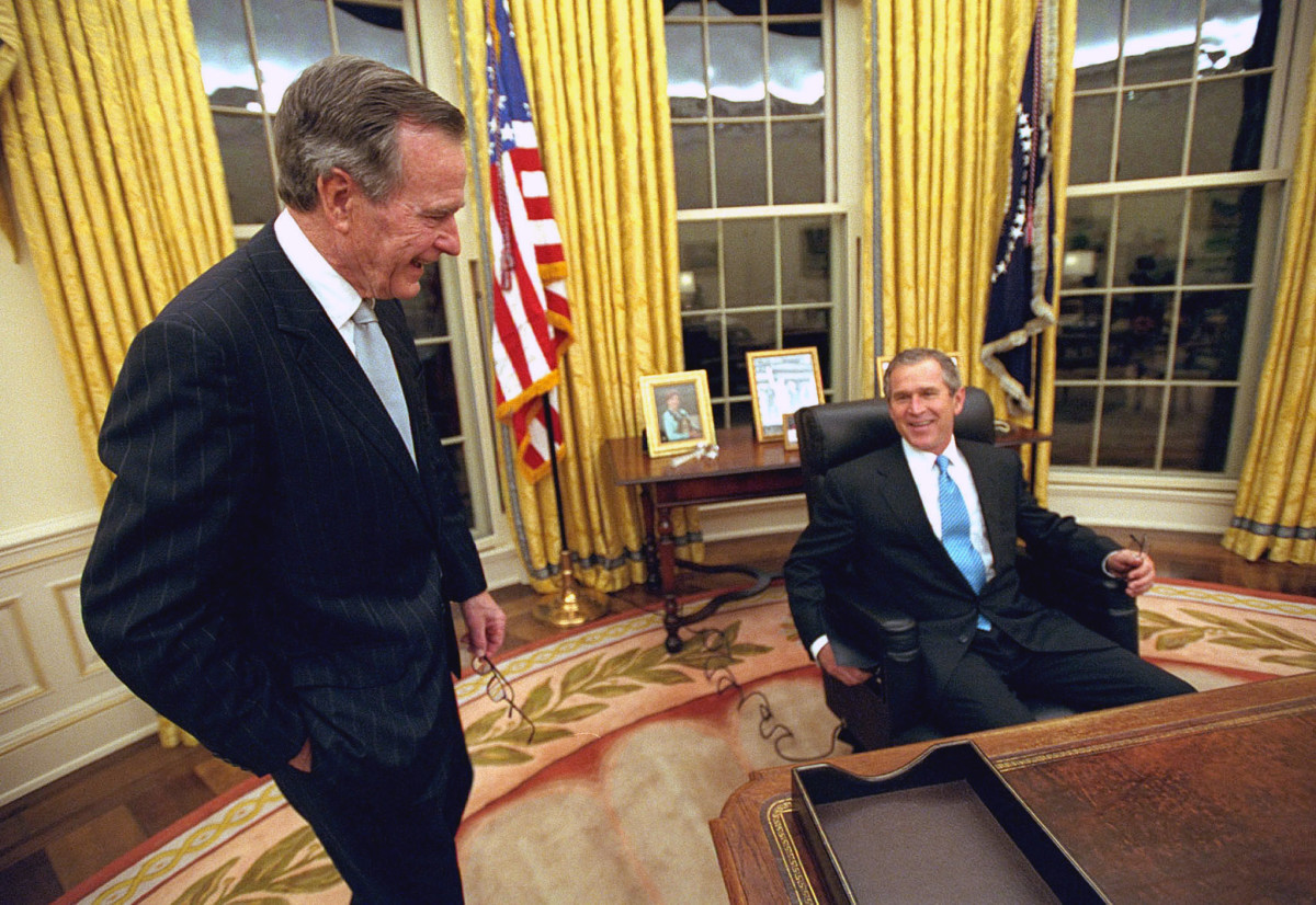 President George W. Bush talking to former President George H.W. Bush
