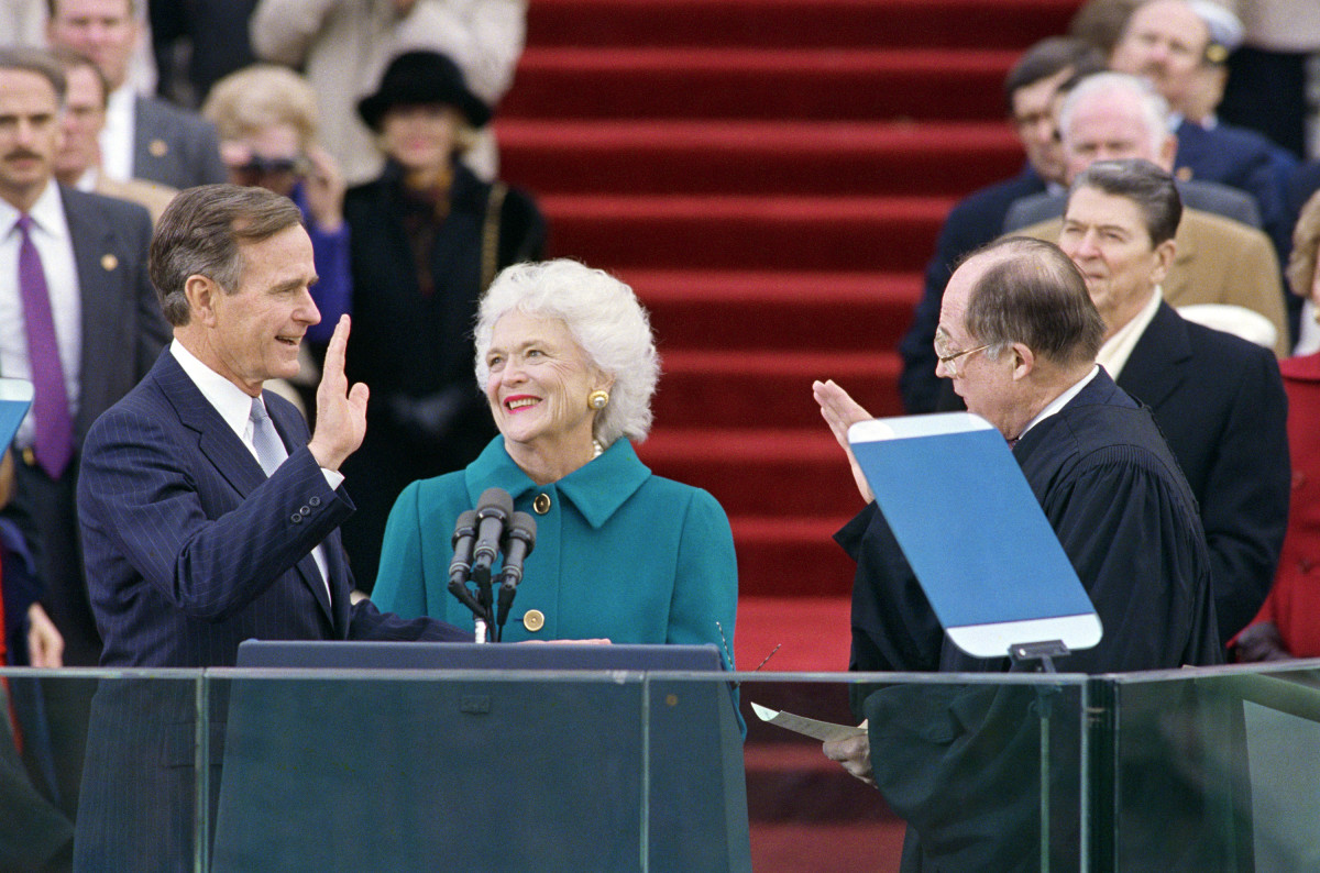 Barbara Bush, lovingly looking on as her husband George Bush is sworn in as President of the United States.