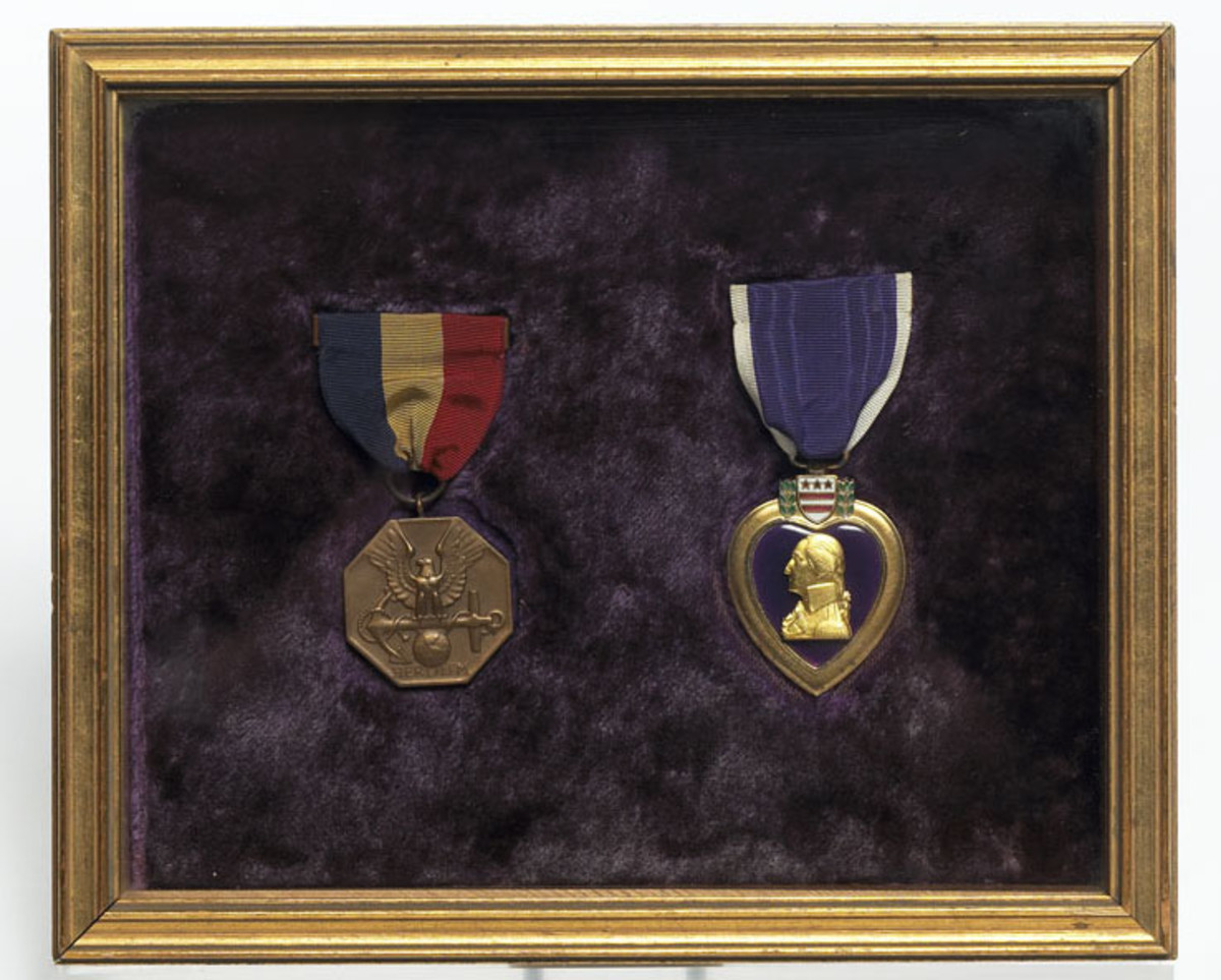 The Navy Marine Corps Medal and the Purple Heart presented to John F. Kennedy in 1944.