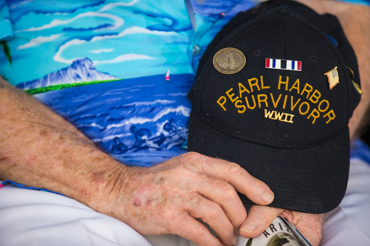 Pearl Harbor Survivor Paul Kennedy of Indiana holding his hat during the singing of the National Anthem at the 71st Annual Memorial Ceremony on December 7, 2012.