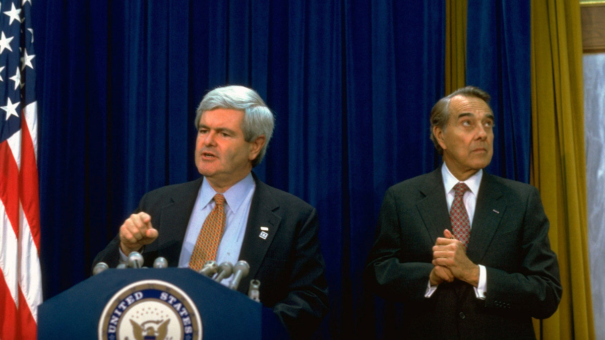 House Speaker Newt Gingrich discussing budget impasse, on the brink of shutdown of the Federal Government, at a news conference with Senator Bob Dole.