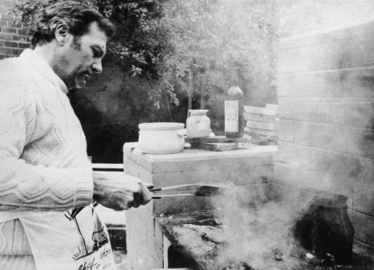 John Stonehouse tending a barbecue at a house near Melbourne while living under the assumed name of Donald Clive Mildoon after faking his death.