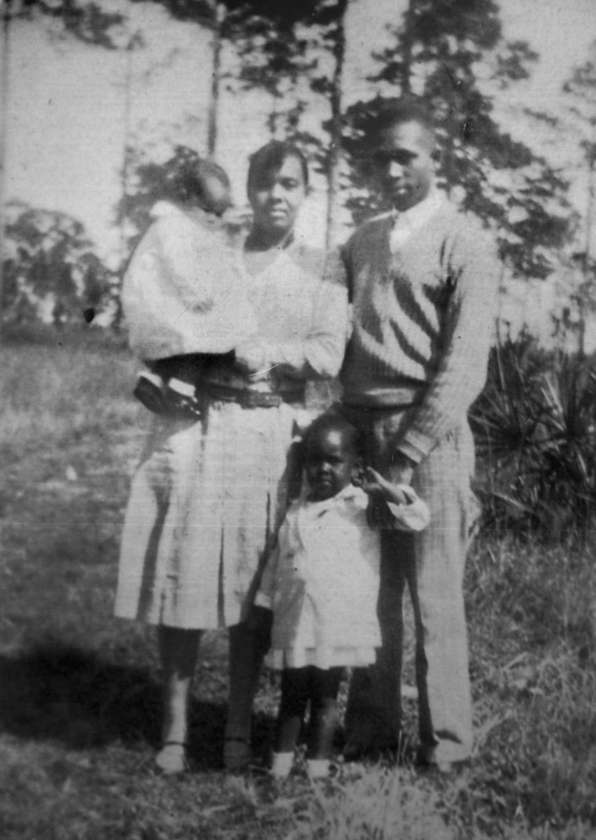 Family photo of Harry T. Moore and wife Harriette with their young daughters Evangeline and Annie Rosalea, circa 1931.