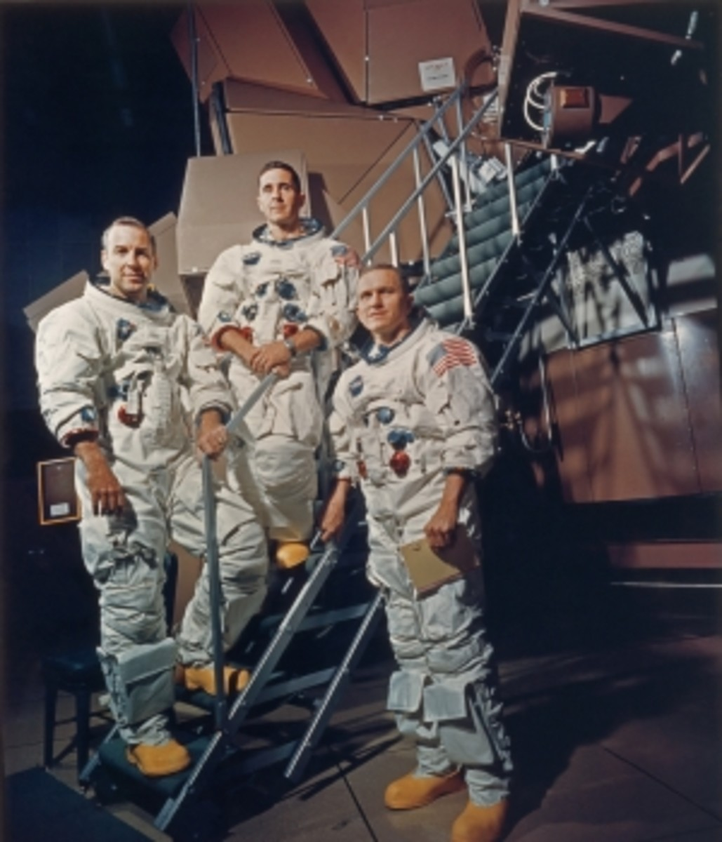 The crew of Apollo 8 in their space suits on a Kennedy Space Center simulator. Left to right: James A. Lovell Jr., William A. Anders and Frank Borman.