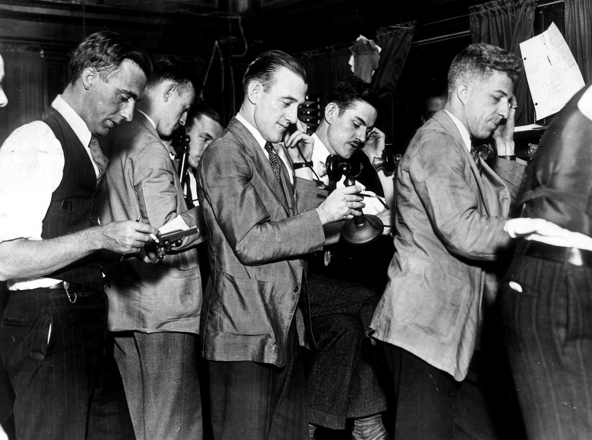 "Stock brokers at the New York Stock Exchange on ""Black Thursday."""