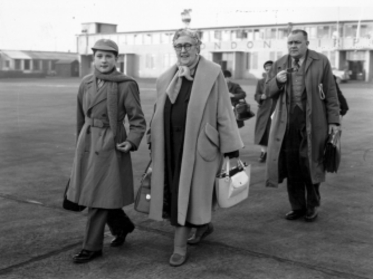 English crime writer Agatha Christie at London Airport with her grandson, Matthew Pritchard.